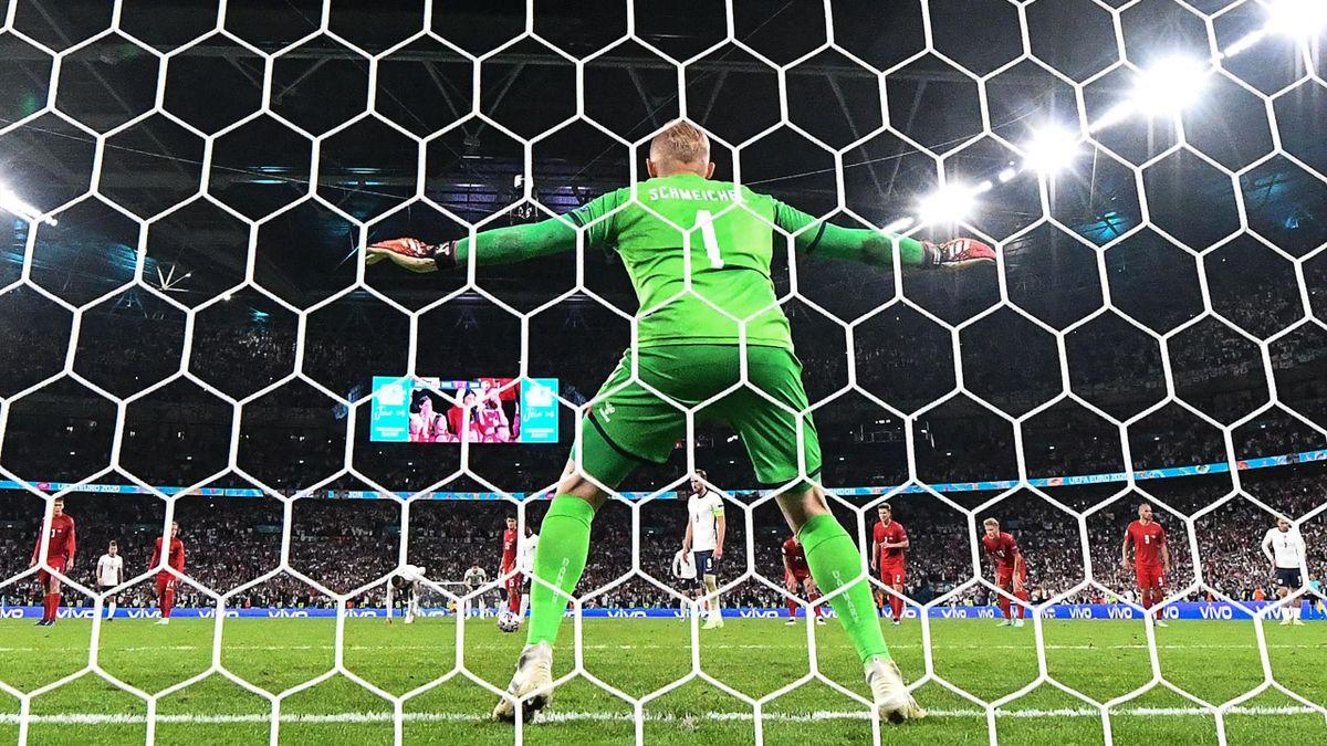 Denmark's goalkeeper Kasper Schmeichel gets ready as England's forward Harry Kane (C-Back) takes a penalty kick during the UEFA EURO 2020 semi-final football match between England and Denmark