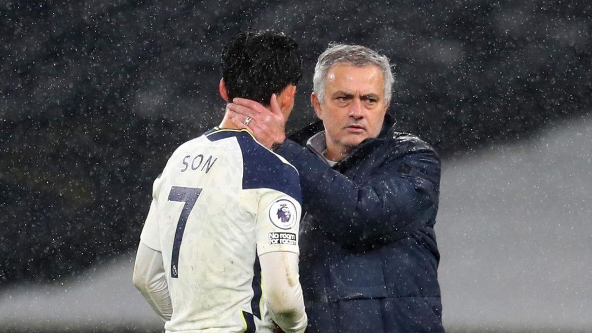 Tottenham Hotspur's Portuguese head coach Jose Mourinho (R) greets Tottenham Hotspur's South Korean striker Son Heung-Min