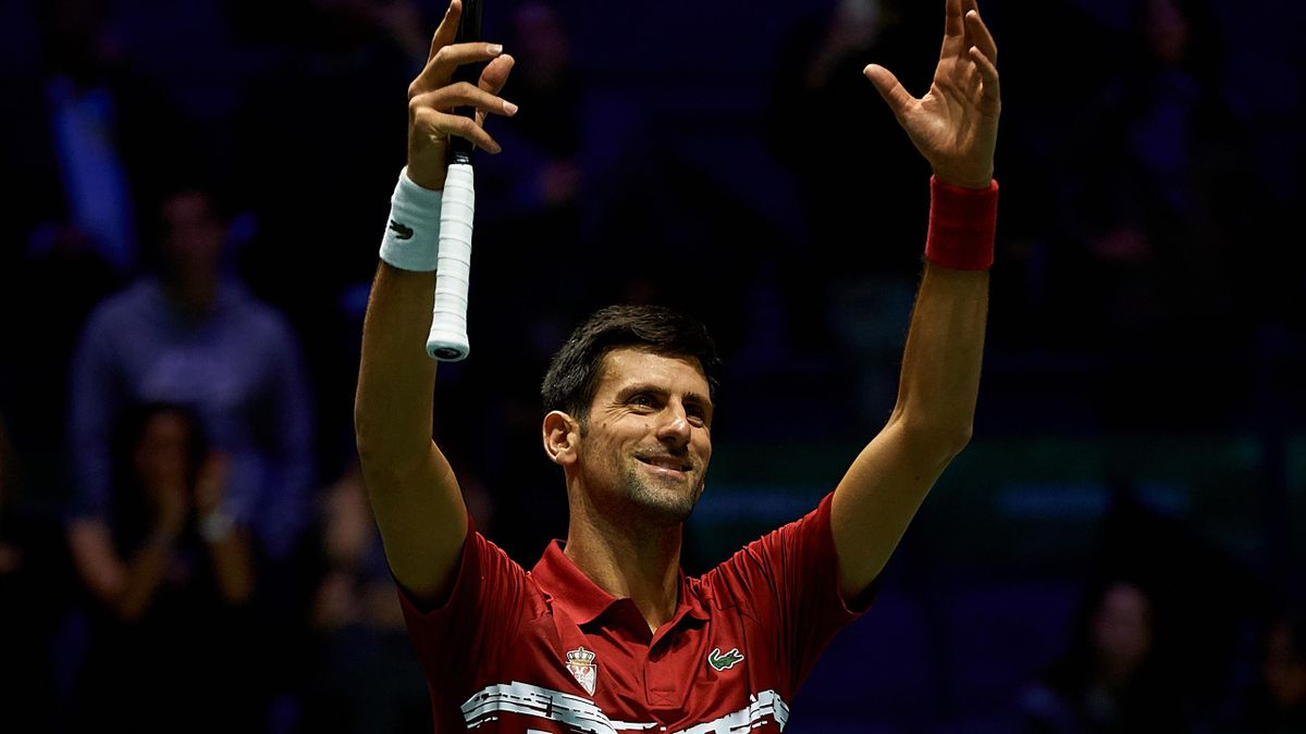 Novak Djokovic of Serbia celebrates winning match point in his quarter final singles match against Karen Khachanov of Russia on Day Five of the 2019 Davis Cup at La Caja Magica