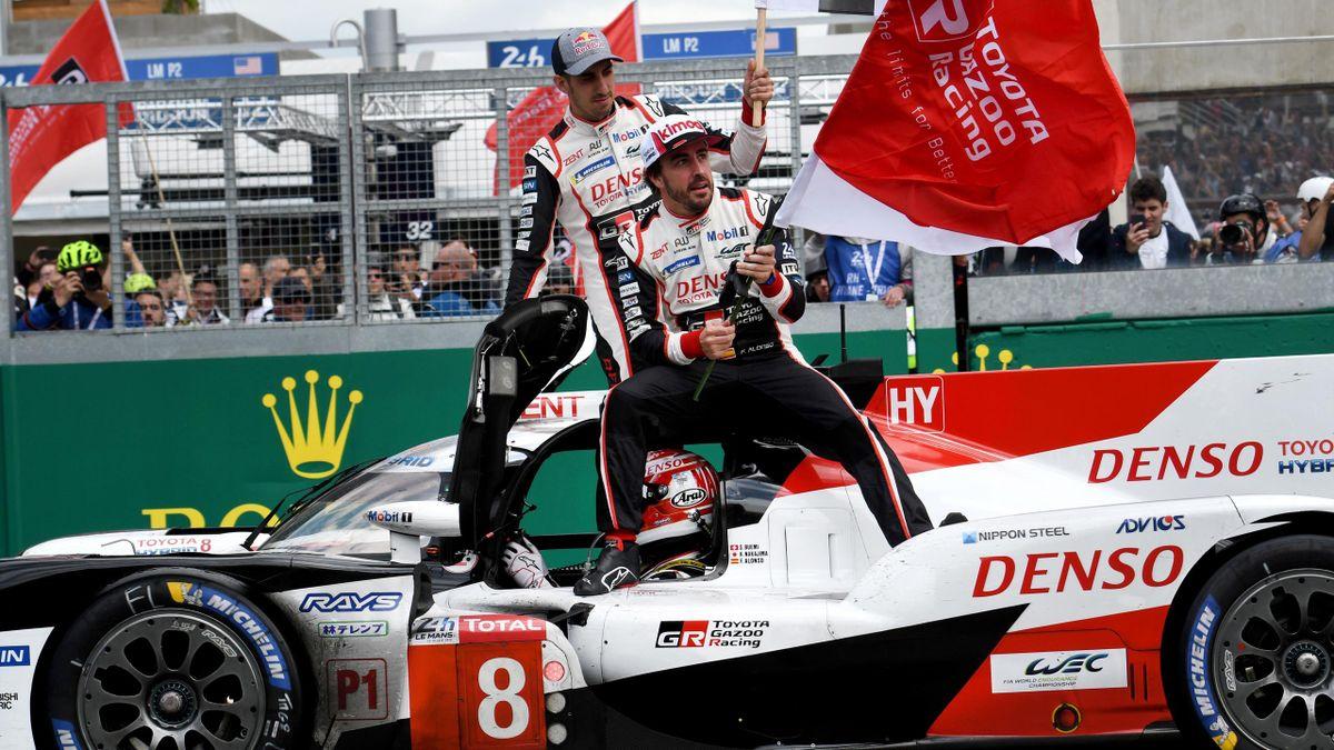 Japanese's driver Kazuki Nakajima (bottom) Spain's driver Fernando Alonso (R) and Switzerland's driver Sebastien Buemi celebrates after winning in the 87th edition.