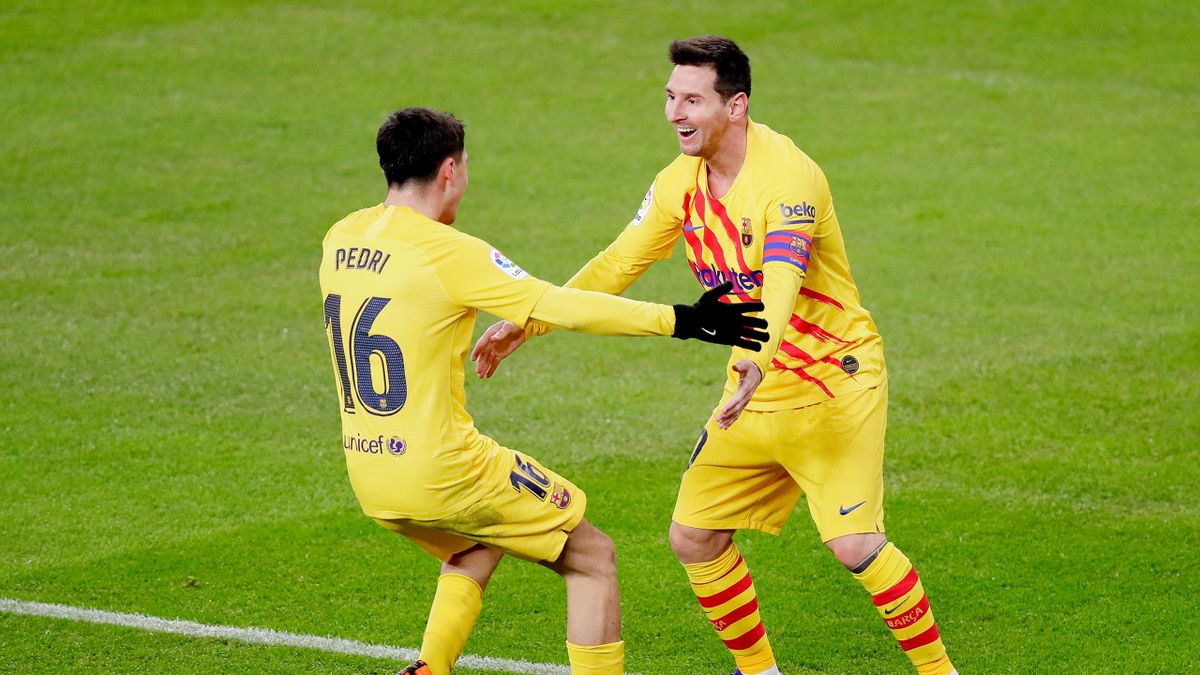 Lionel Messi of FC Barcelona celebrates 1-2 with Pedri of FC Barcelona during the La Liga Santander match between Athletic de Bilbao v FC Barcelona at the Estadio San Mames on January 6, 2021 in Bilbao Spain