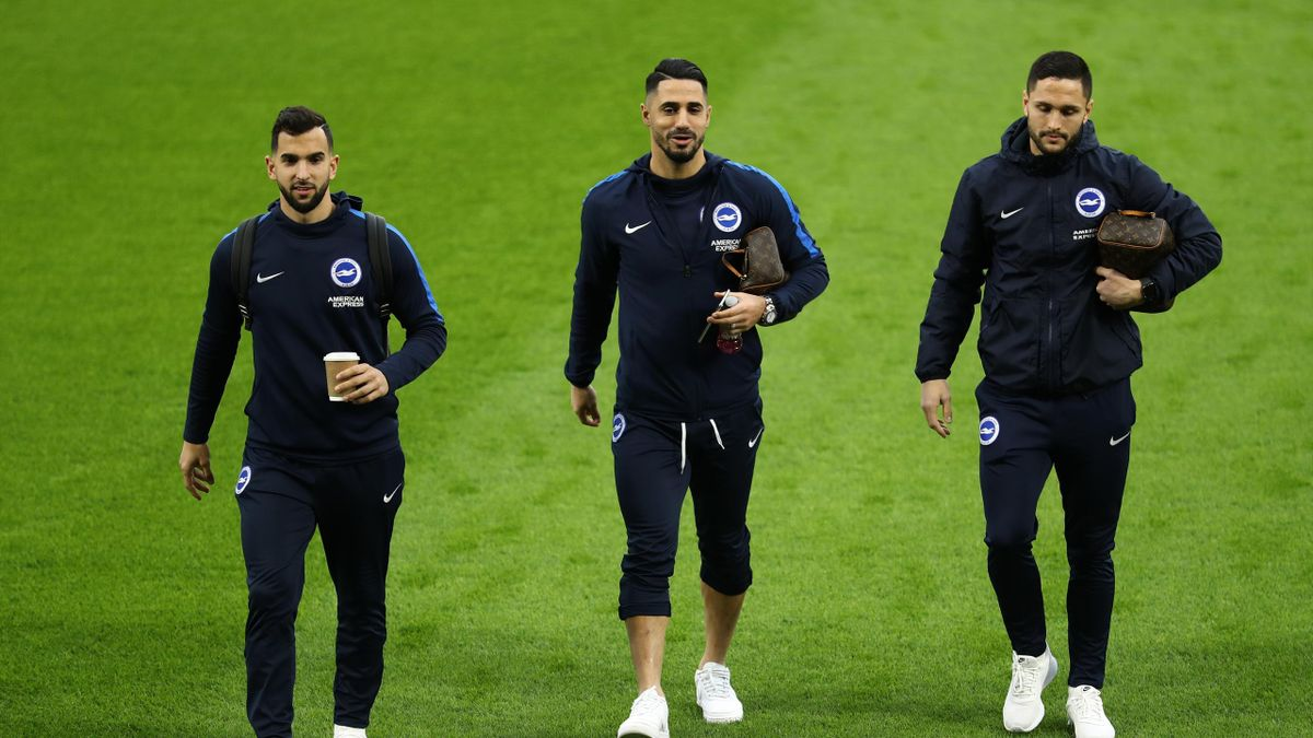 Martin Montoya, Beram Kayal and Florin Andone of Brighton and Hove Albion inspects the pitch prior to the Premier League match between Brighton & Hove Albion and Liverpool FC at American Express Community Stadium on January 12, 2019 in Brighton, United Ki