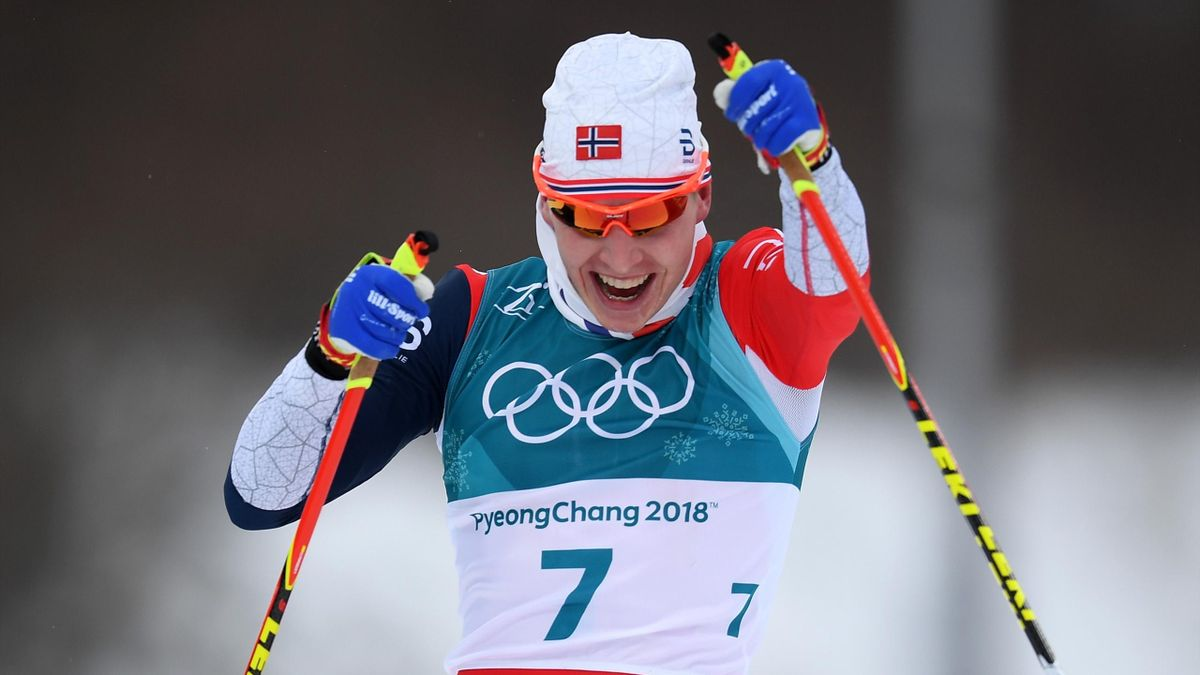 Simen Hegstad Krueger of Norway celebrates winning the gold medal during the Men's 15km and 15km Skiathlon Cross-Country Skiing on day two of the PyeongChang 2018 Winter Olympic Games at Alpensia Cross-Country Centre