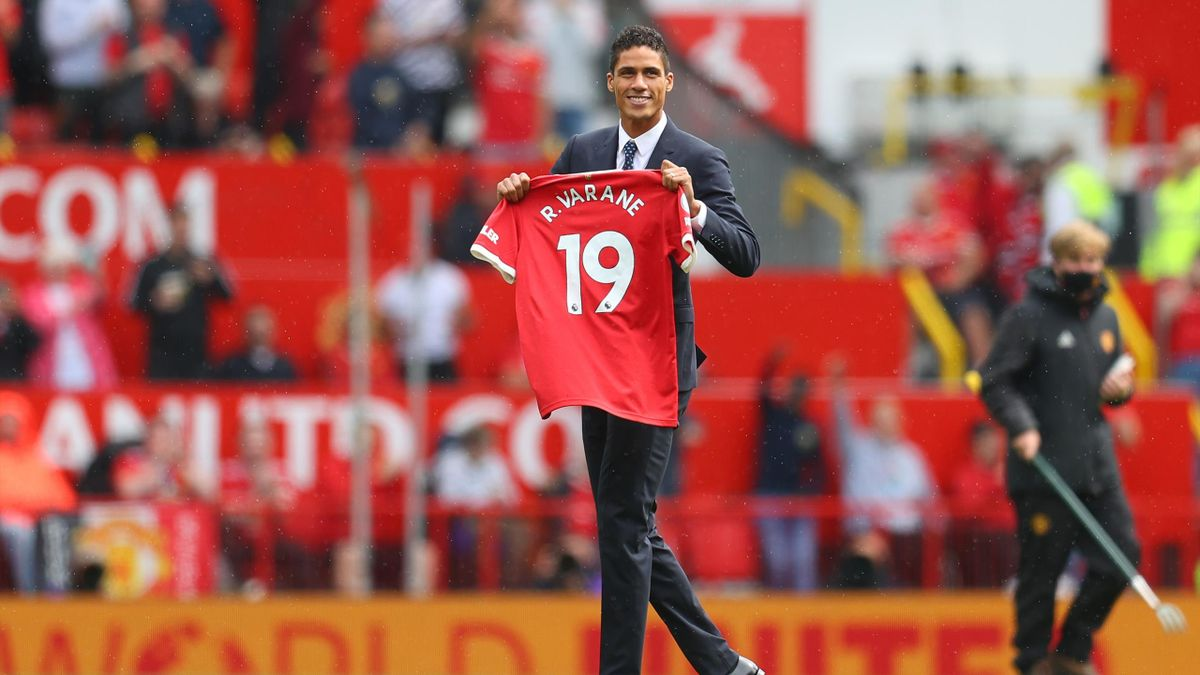 Raphael Varane parades before the Manchester United fans, Old Trafford, August 14, 2021