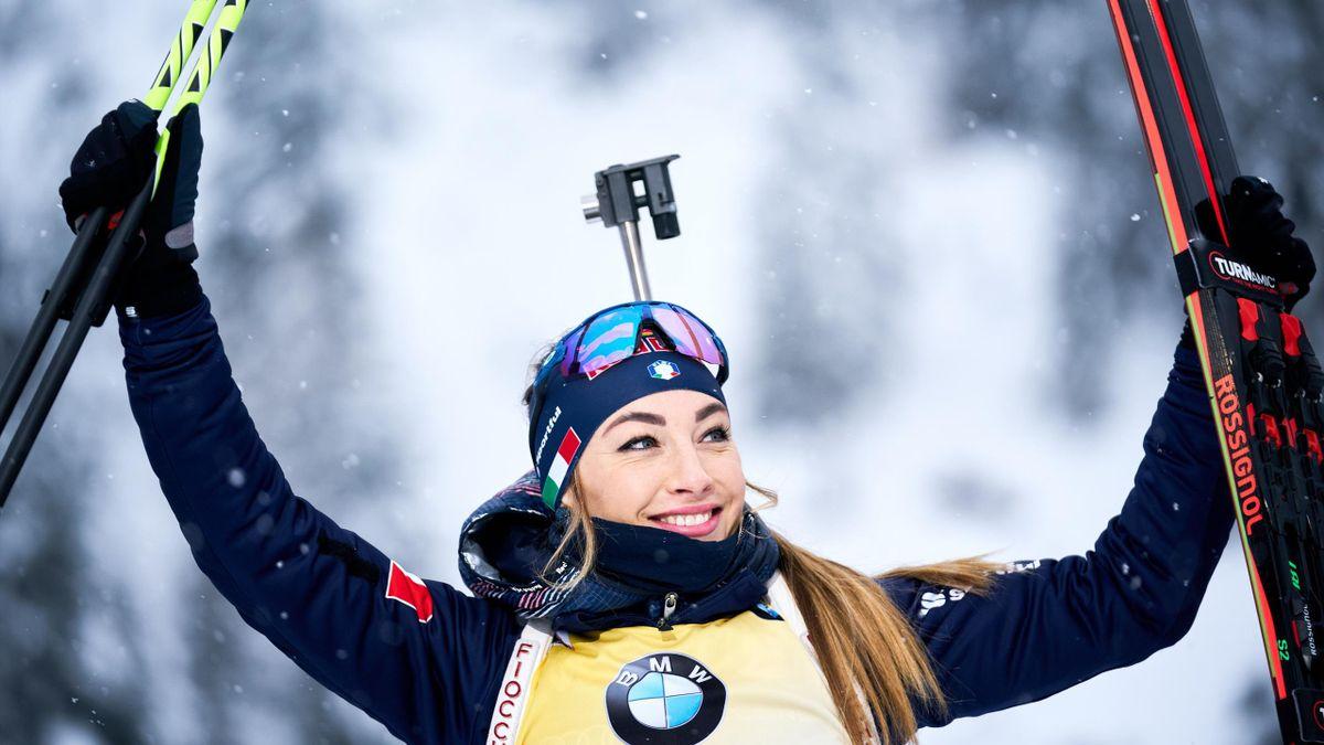 Italy's Dorothea Wierer celebrates winning the women 7,5 km sprint competition of the IBU Biathlon World Cup in Hochfilzen, Austria, on December 13, 2019