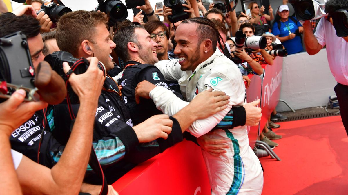 Mercedes' British driver Lewis Hamilton celebrates with his staff after winning the German Formula One Grand Prix at the Hockenheim racing circuit on July 22, 2018 in Hockenheim, southern Germany.