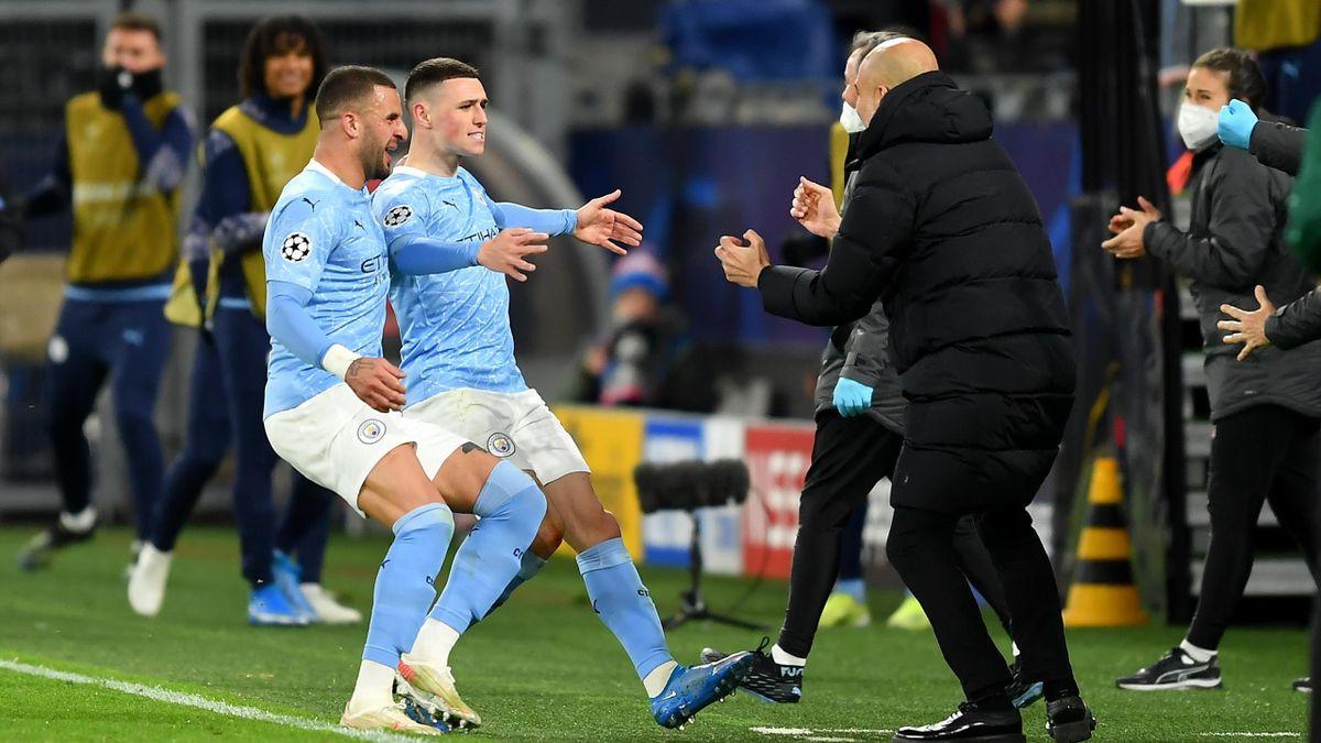 Phil Foden esulta abbracciando Pep Guardiola, Borussia Dortmund-Manchester City, Getty Images