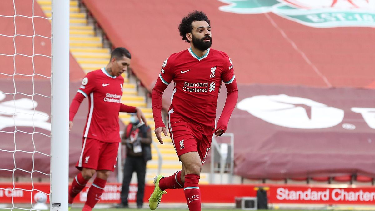 Mohamed Salah of Liverpool celebrates after scoring their team's first goal during the Premier League match between Liverpool and Aston Villa at Anfield on April 10, 2021 in Liverpool, England.