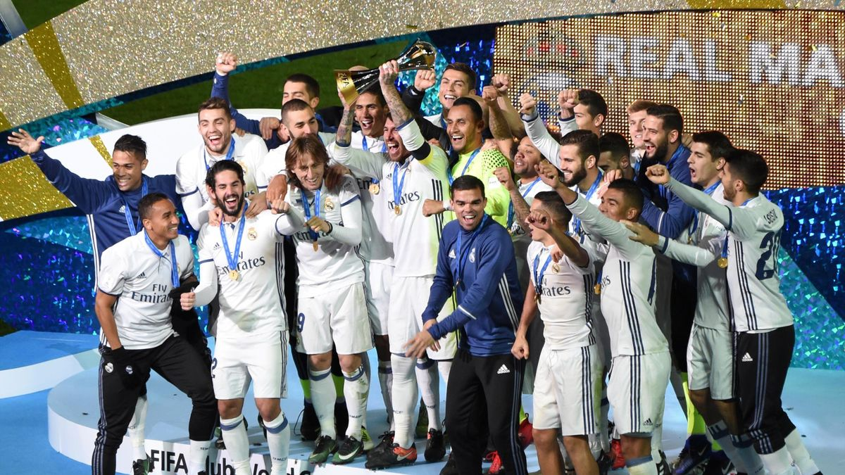 Real Madrid Players and staff celebrate with their trophy after winning the Club World Cup