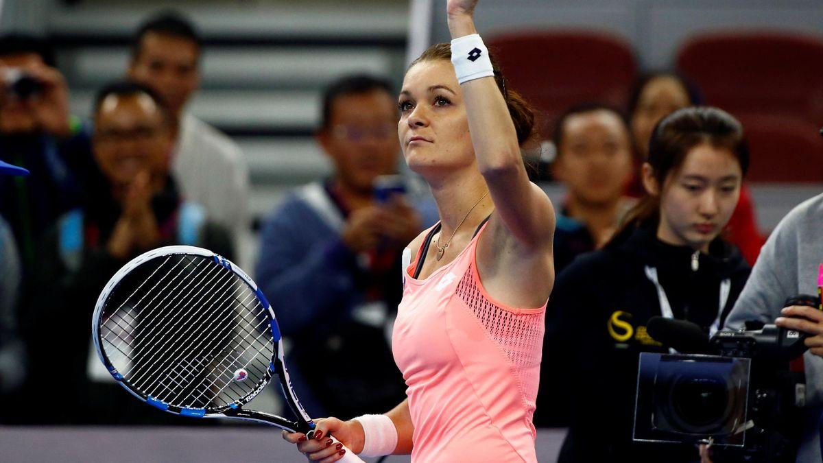 Poland's Agnieszka Radwanska celebrates after defeating Kazakhstan's Yaroslava Shvedova.