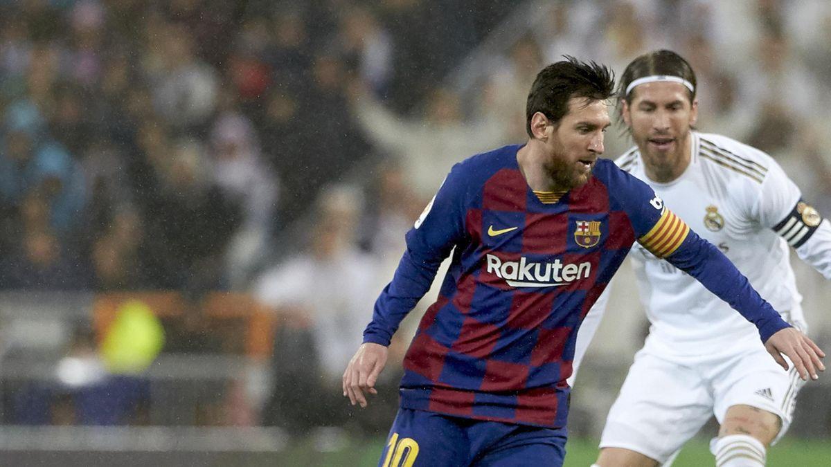 Lionel Messi (v.) im Duell mit Sergio Ramos