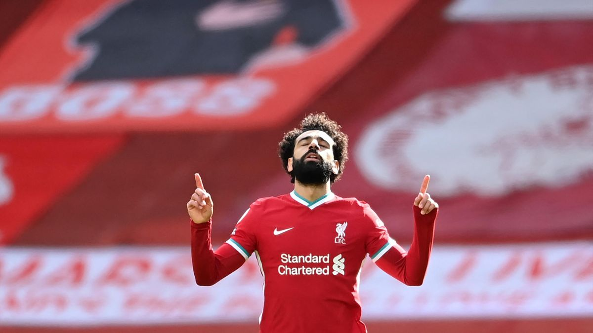 Liverpool's Egyptian midfielder Mohamed Salah celebrates scoring his team's first goal during the English Premier League football match between Liverpool and Aston Villa at Anfield in Liverpool, north west England on April 10, 2021.