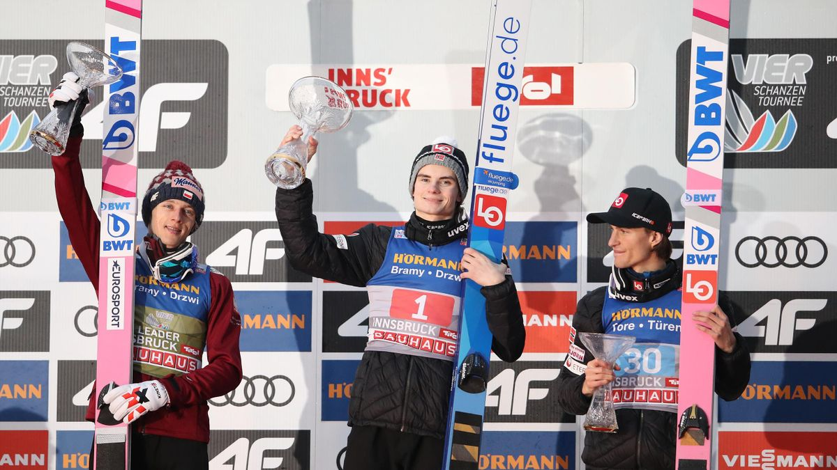 Dawid Kubacki of Poland, Marius Lindvik of Norway and Daniel Andre Tande of Norway celebrate during the medal ceremony of the 68th FIS Nordic World Cup Four Hills Tournament at Bergisel-Stadion Olympiaschanze on January 04, 2020 in Innsbruck, Austria