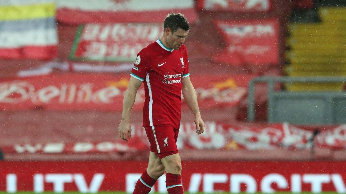James Milner of Liverpool looks dejected following the Premier League match between Liverpool and Brighton & Hove Albion at Anfield