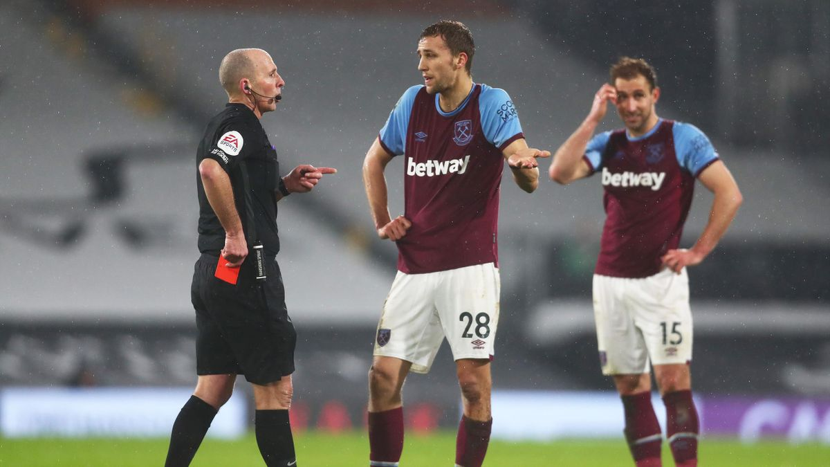 Tomas Soucek of West Ham appeals to match referee Mike Dean after being shown a red card during the Premier League match between Fulham and West Ham United at Craven Cottage on February 06, 2021 in London, England.