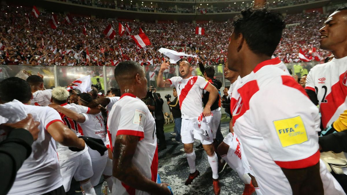 Peruvian players celebrate after defeating New Zealand by 2-0 and qualifying for the 2018 football World Cup, in Lima, Peru, on November 15, 2017