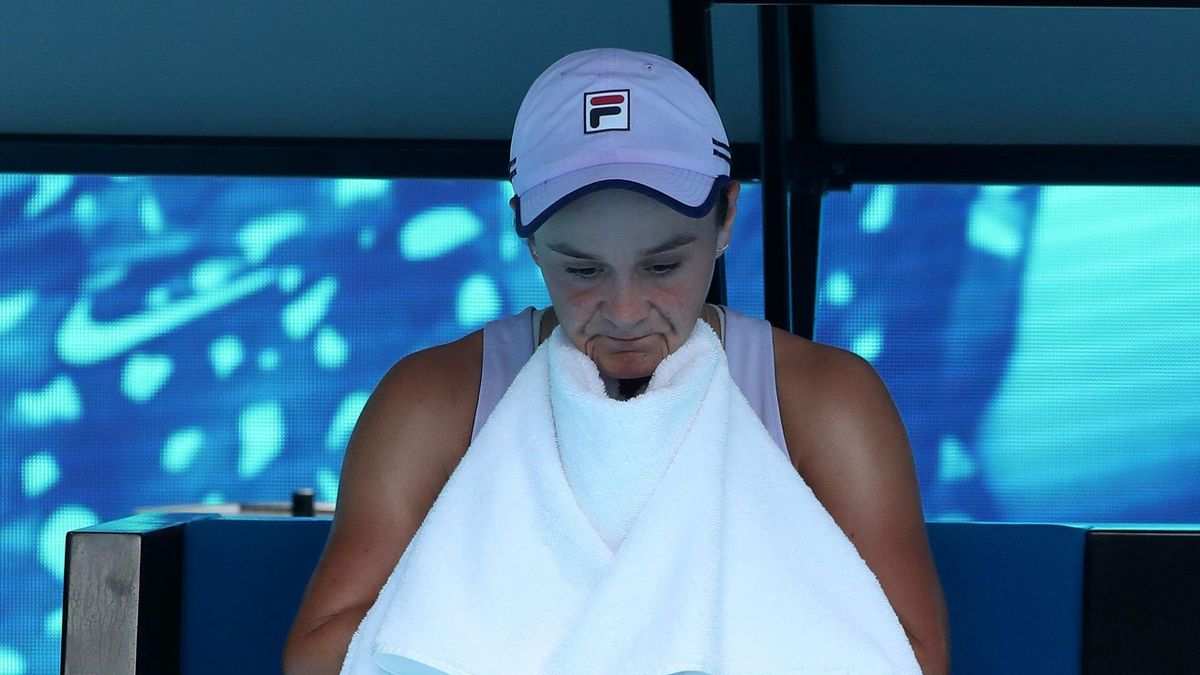 Australia's Ashleigh Barty wipes her face between the games against Australia's Daria Gavrilova during their women's singles match on day four of the Australian Open tennis tournament in Melbourne