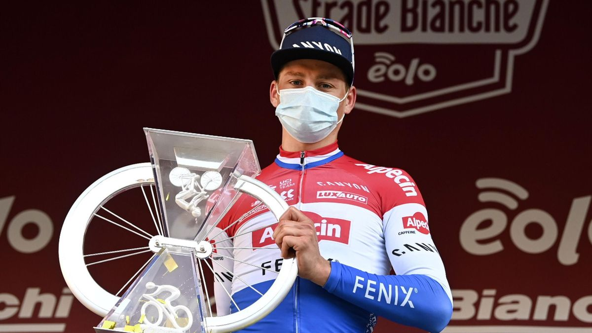 Dutch Mathieu van der Poel of Alpecin-Fenix celebrates on the podium after winning the 'Strade Bianche' one day cycling race (184km) from and to Siena, Italy