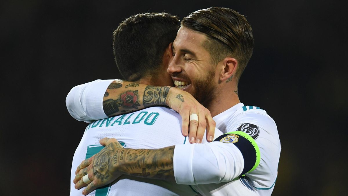Real Madrid's forward from Portugal Cristiano Ronaldo (L) celebrates scoring with Real Madrid's defender from Spain Sergio Ramos during the UEFA Champions League Group H football match BVB Borussia Dortmund v Real Madrid in Dortmund, western Germany on Se