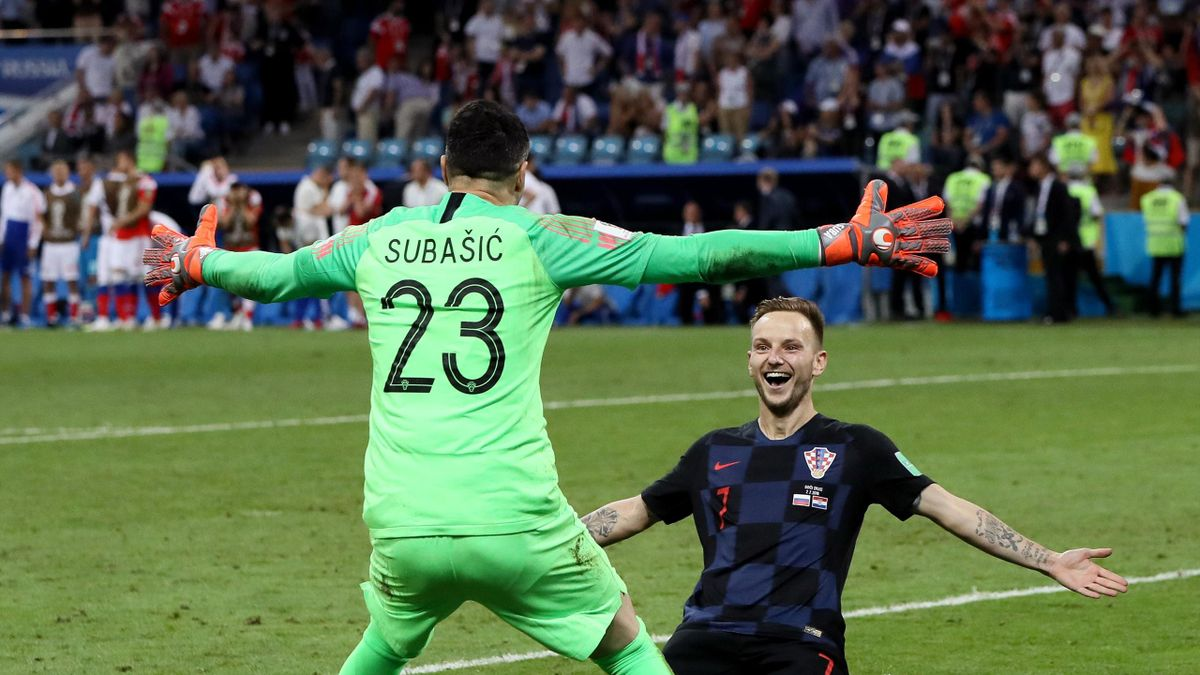 Ivan Rakitic of Croatia celebrates with Danijel Subasic of Croatia after he scores his team's fifth penalty, the winning penalty, in the penalty shoot out during the 2018 FIFA World Cup Russia Quarter Final match between Russia and Croatia at Fisht Stadiu
