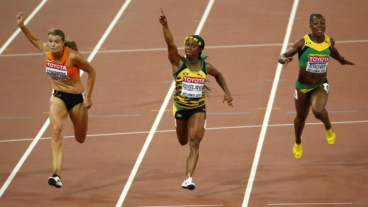 Shelly-Ann Fraser-Pryce of Jamaica (C) celebrates winning the women's 100 metres final as she crosses the finish line ahead of Dafne Schippers of Netherlands (L) and Veronica Campbell-Brown of Jamaica (R) during the15th IAAF World Championships at the Nat