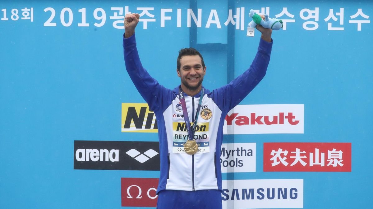 Axel Reymond of France celebrates during the medal ceremony of the Men's 25km Final on day six of the Gwangju 2019 FINA World Championships at Yeosu EXPO Ocean Park on July 19, 2019