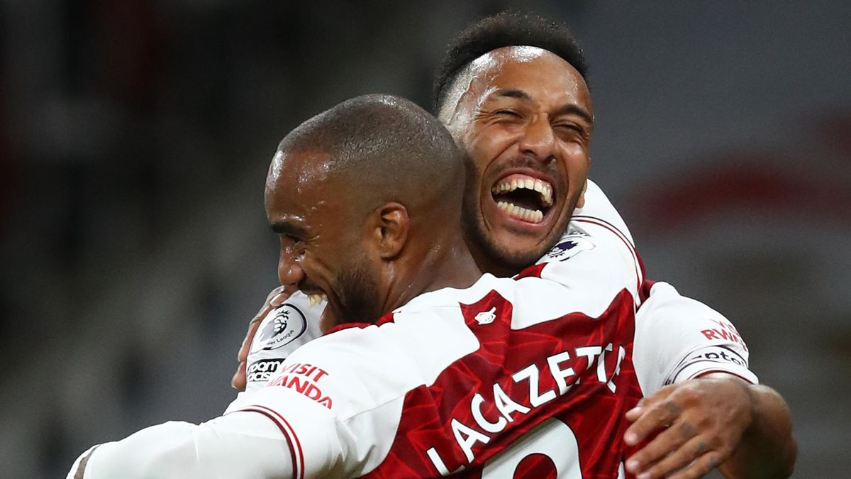 Alexandre Lacazette of Arsenal celebrates with teammate Pierre-Emerick Aubameyang