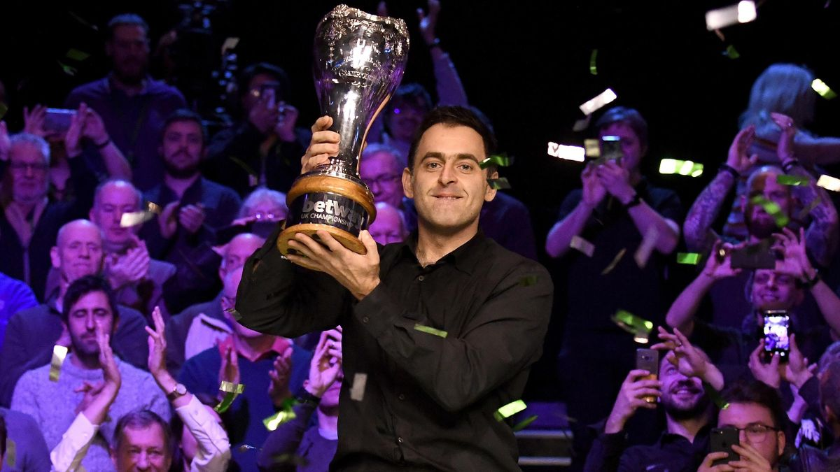 Ronnie O'Sullivan celebrates with the trophy after winning the final of the Betway UK Snooker Championship 2018.
