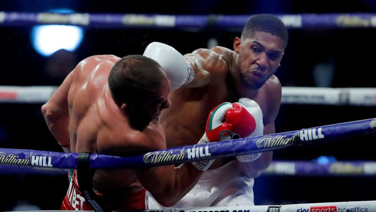 Anthony Joshua punches Kubrat Pulev during the IBF, WBA, WBO and IBO World Heayweight Title fight between Anthony Joshua and Kubrat Pulev