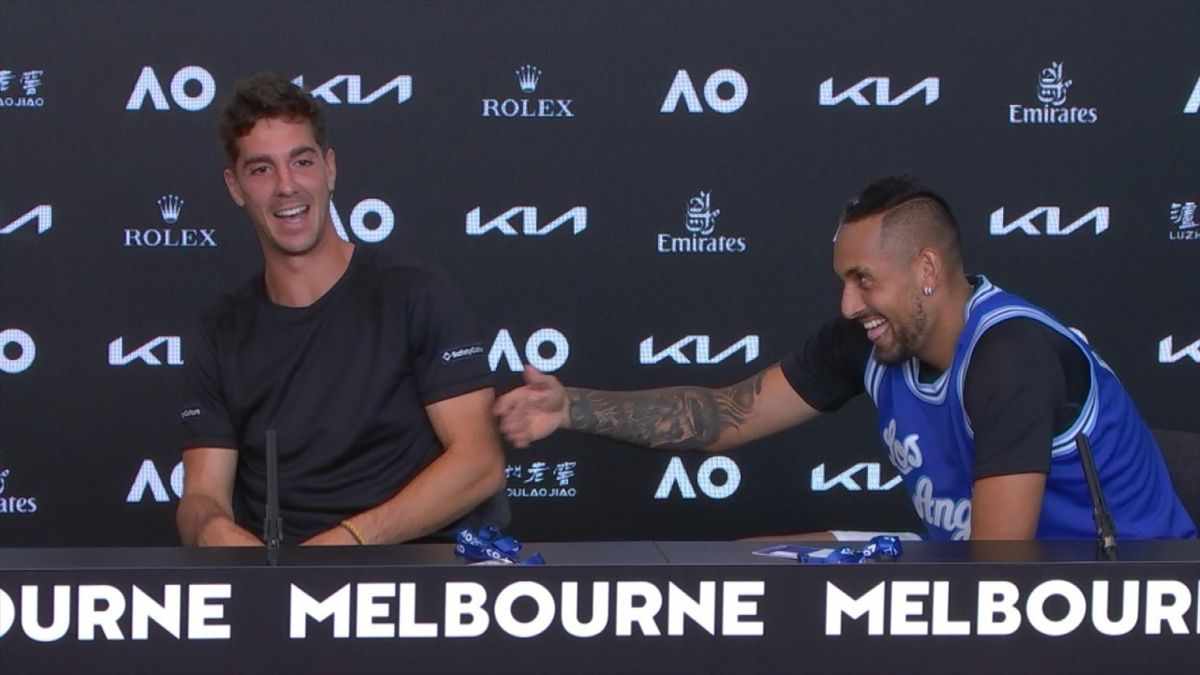 Thanasi Kokkinakis and Nick Kyrgios laugh with each other at the 2021 Australian Open
