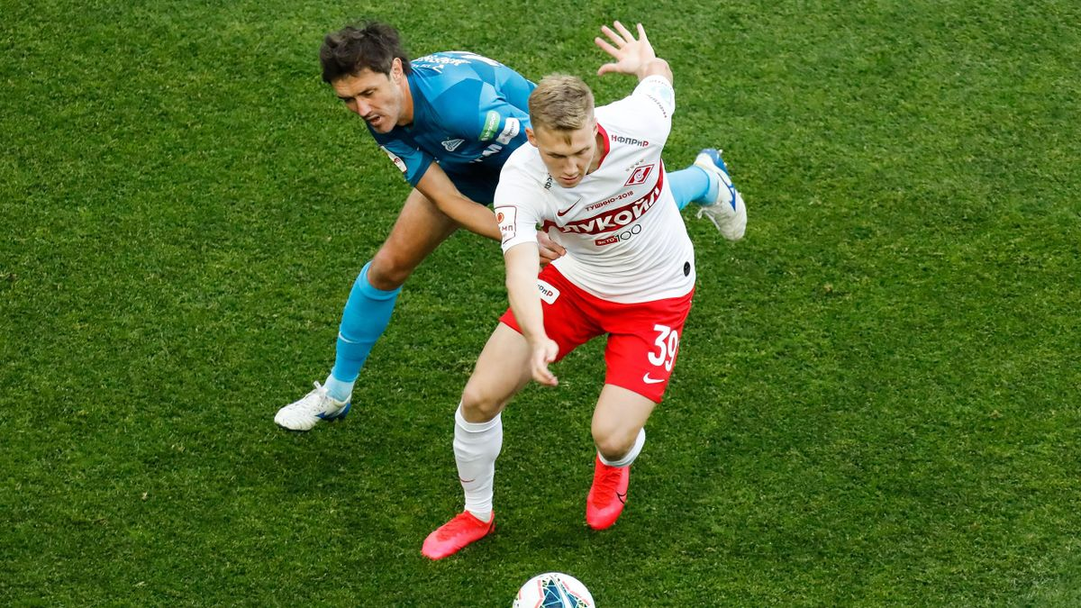 Yuri Zhirkov (L) of Zenit Saint Petersburg and Pavel Maslov of Spartak Moscow vie for the ball during the Russian Cup semi final match between FC Zenit Saint Petersburg and FC Spartak Moscow on July 19, 2020 at Gazprom Arena in Saint Petersburg, Russia