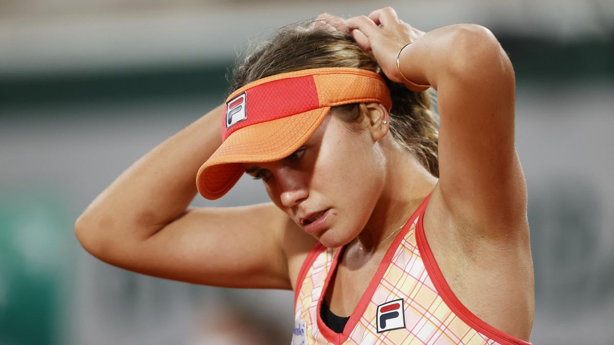 Sofia Kenin of The United States of America adjusts her hair during her Women's Singles fourth round match against Fiona Ferro of France on day nine of the 2020 French Open at Roland Garros on October 05, 2020