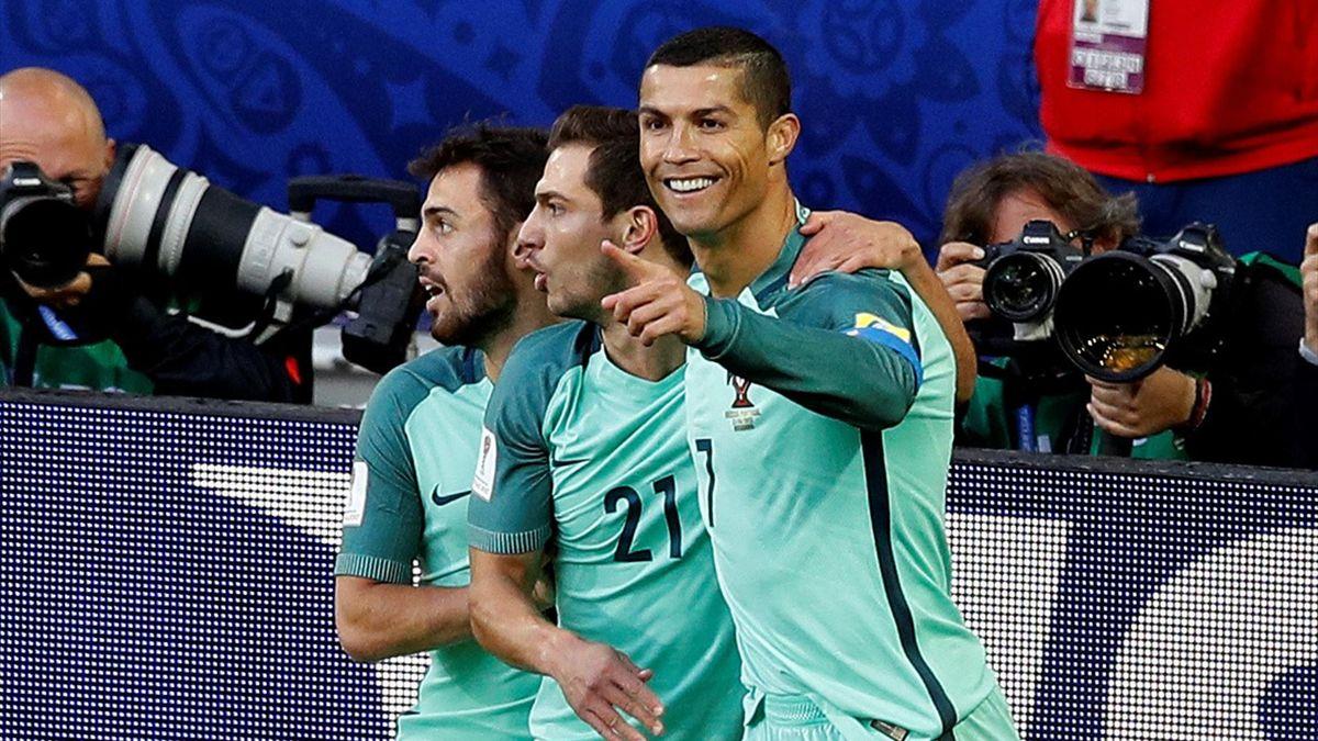 Portugal's Cristiano Ronaldo celebrates scoring their first goal with team mates