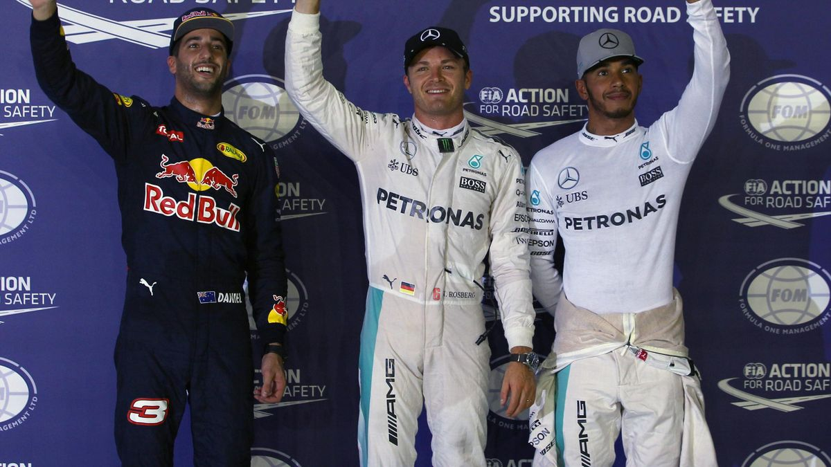 Mercedes' Nico Rosberg of Germany celebrates qualifying in pole position with Lewis Hamilton of Britain and Red Bull's Daniel Ricciardo.