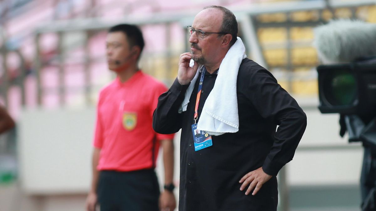 Dalian Pro coach Rafael Benitez (R) looks on during their Chinese Super League football match against Guangzhou R&F in Dalian, in China's northeast Liaoning province on August 16, 2020.