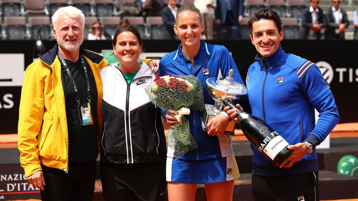 Karolina Pliskova of the Czech Republic poses for a photograph with husband Michal Hrdlicka (far right) and her coach Conchita Martinez (second from left) after her straight sets victory against Johanna Konta.