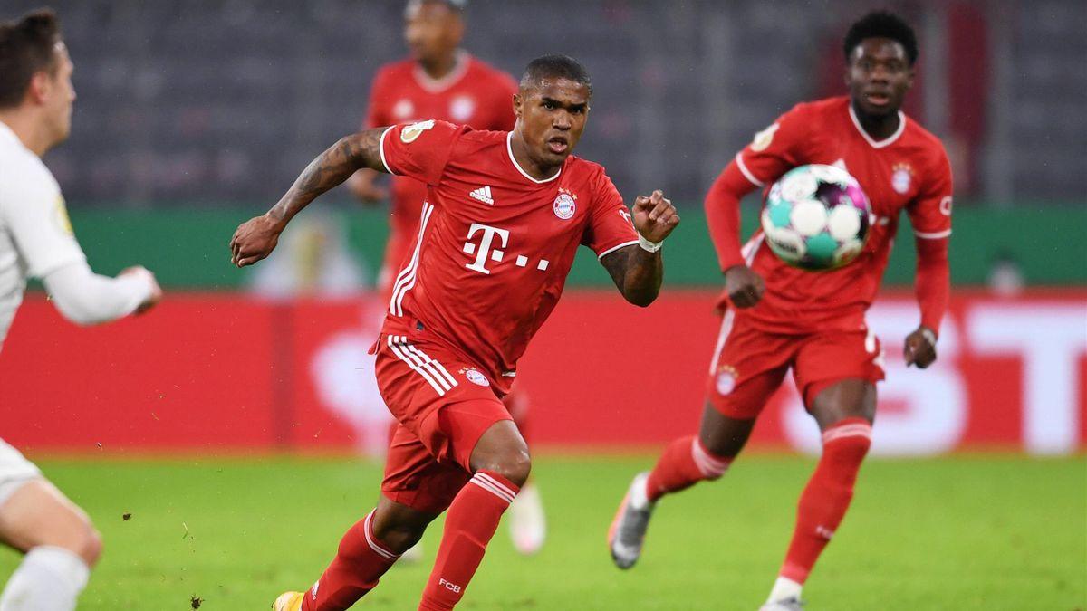 Douglas Costa (vorne) und Alphonso Davies | FC Bayern