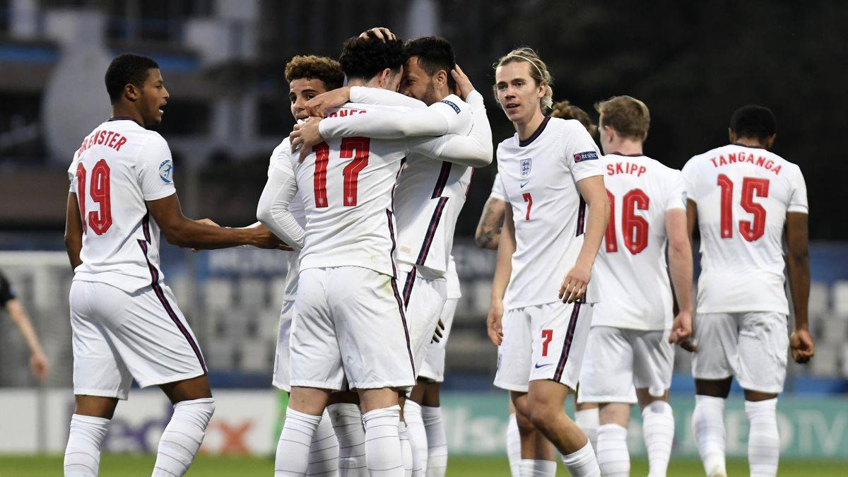 Curtis Jones of England celebrates with team mate Dwight McNeil after scoring their side's second goal during the 2021 UEFA European Under-21 Championship Group D match between Croatia and England at Stadion Bonifika on March 31, 2021 in Koper, Slovenia