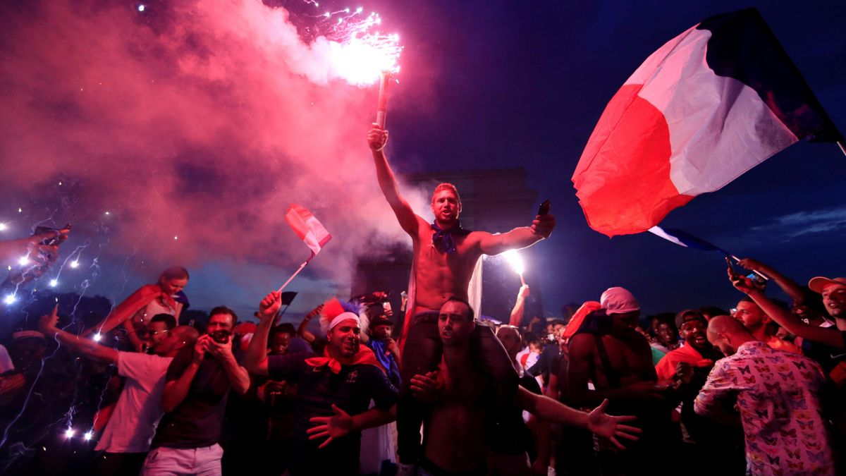 France fans celebrate in front of the Arc de Triomphe on the Champs-Elysees Avenue after France won the World Cup final.