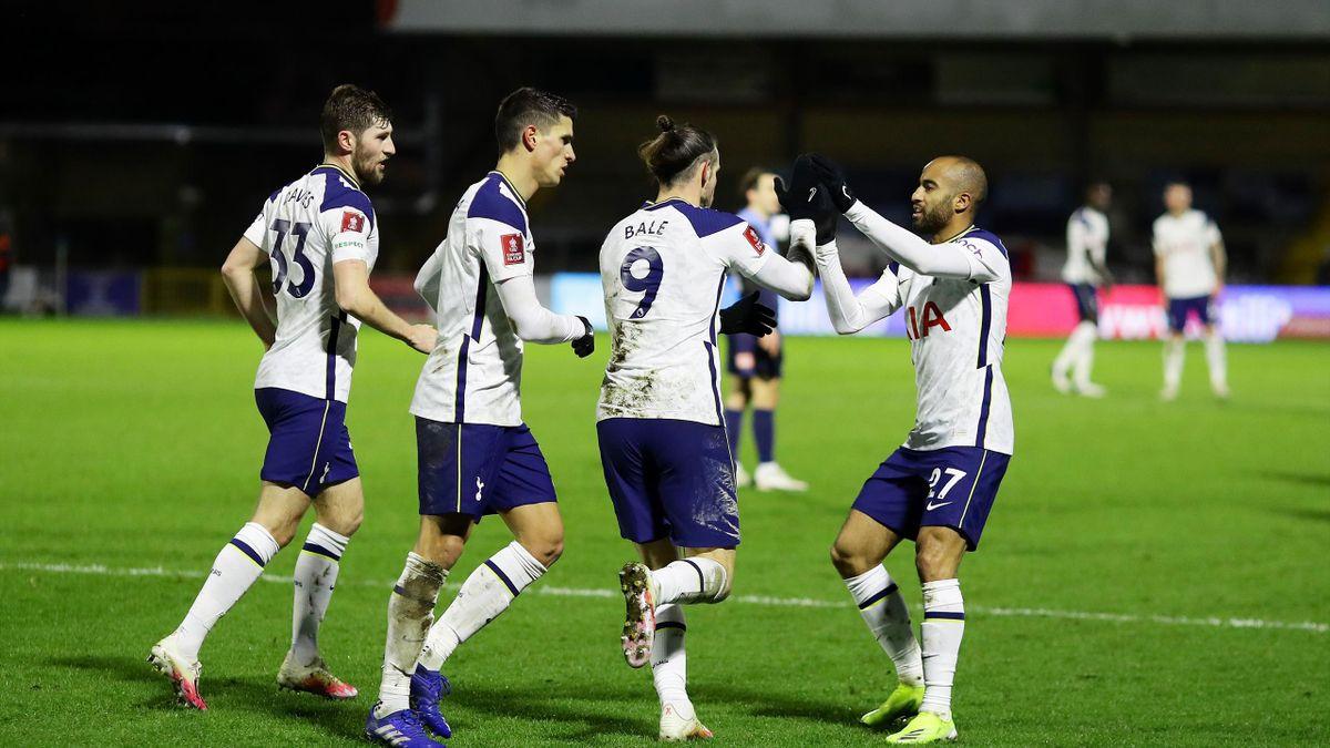 Gareth Bale of Tottenham Hotspur celebrates after scoring their sides first goal with team mates (L-R) Ben Davies, Erik Lamela and Lucas