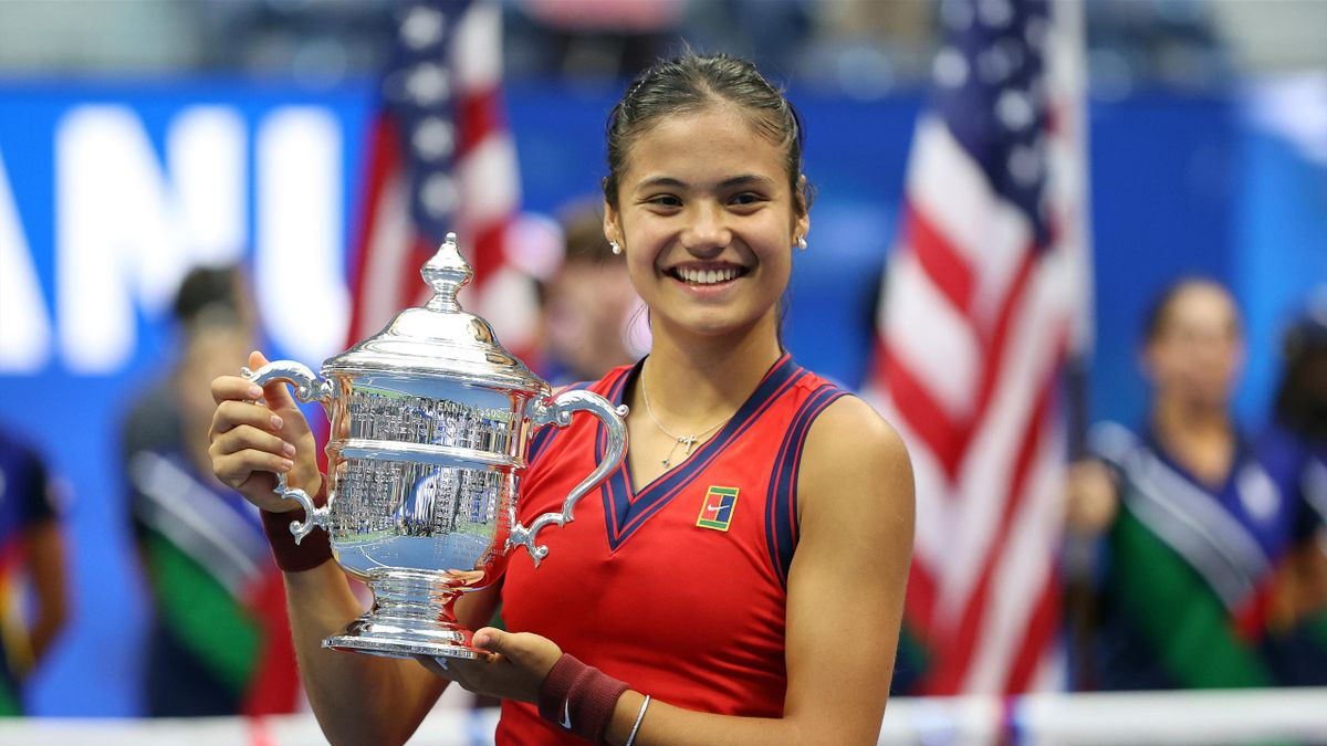 Emma Raducanu of Great Britain celebrates with the championship trophy after defeating Leylah Annie Fernandez of Canada during their Women's Singles final match on Day Thirteen of the 2021 US Open at the USTA Billie Jean King National Tennis Center
