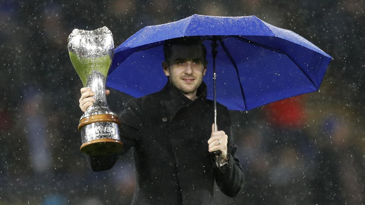 World champion Mark Selby comes on to the pitch during Leicester's match with Everton to parade the UK Championship trophy.