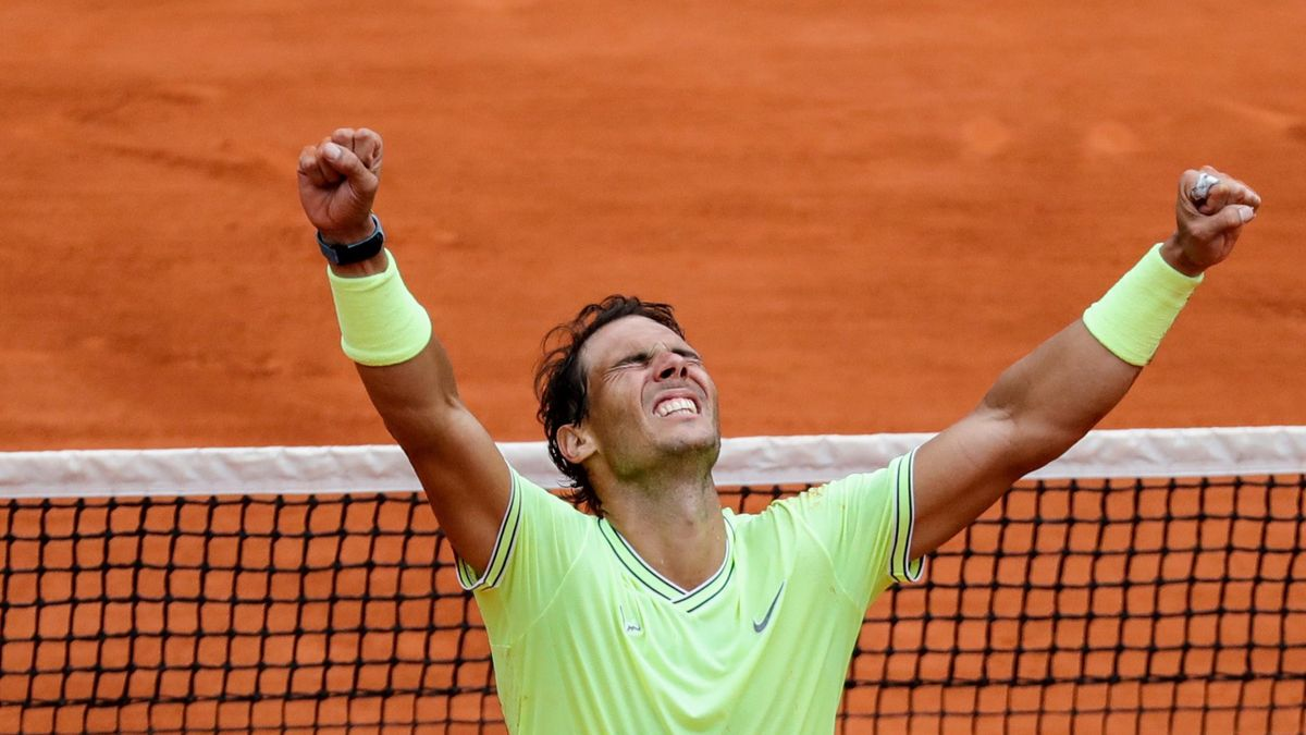 Spain's Rafael Nadal celebrates after winning against Austria's Dominic Thiem during their men's singles final match, on day fifteen of The Roland Garros 2019 French Open tennis tournament in Paris on June 9, 2019.