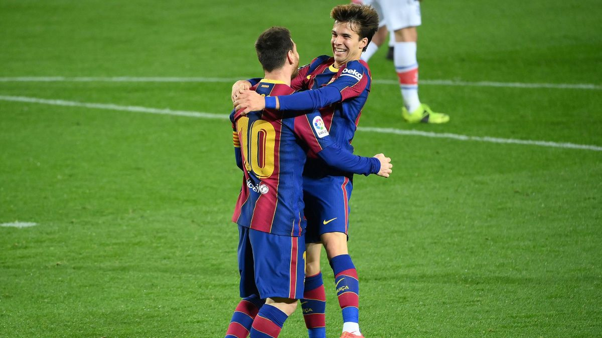 Barcelona's Argentinian forward Lionel Messi celebrates with Barcelona's Spanish midfielder Riqui Puig