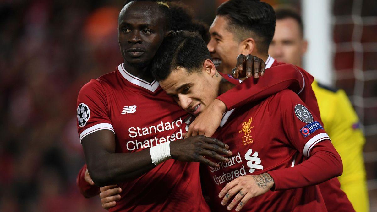 Liverpool's Brazilian midfielder Philippe Coutinho (C) celebrates scoring their fifth goal