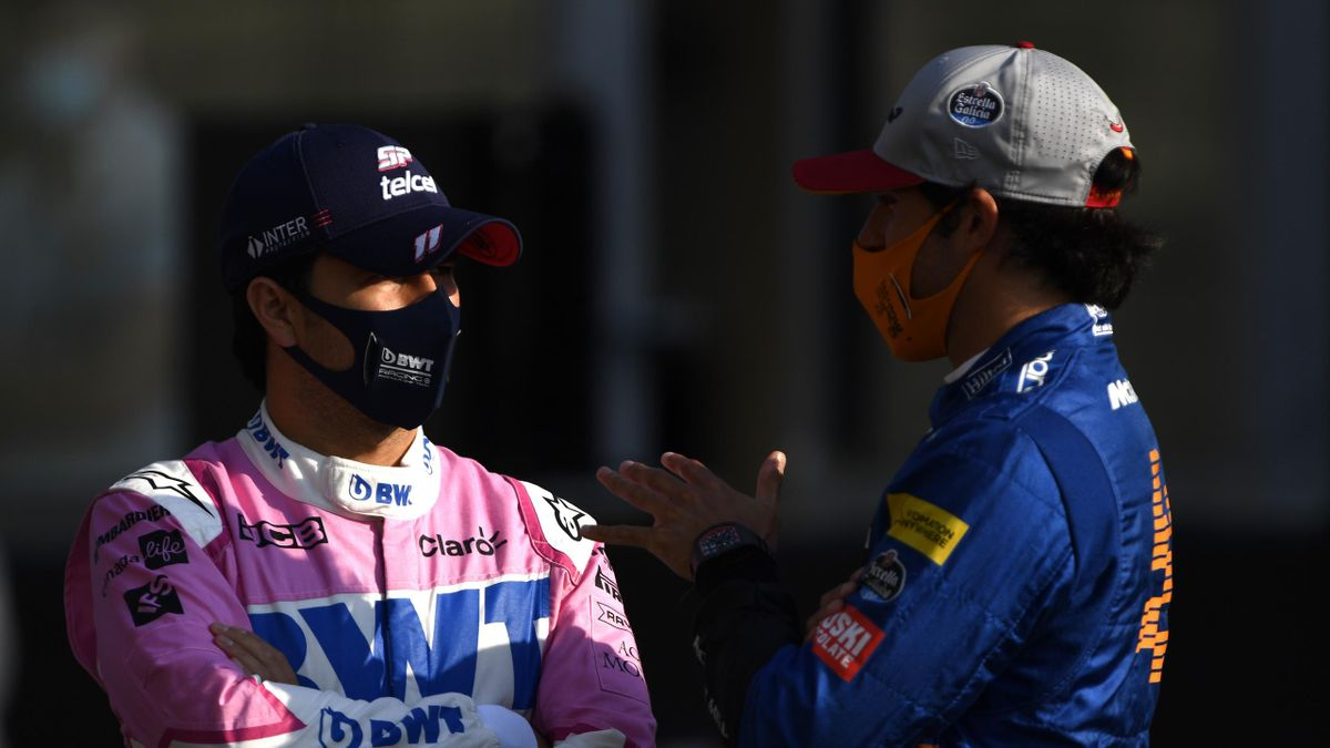 Sergio Perez of Mexico and Racing Point talks with Carlos Sainz of Spain and McLaren F1 on the grid prior to the F1 Grand Prix of Abu Dhabi at Yas Marina Circuit on December 13, 2020 in Abu Dhabi, United Arab Emirates