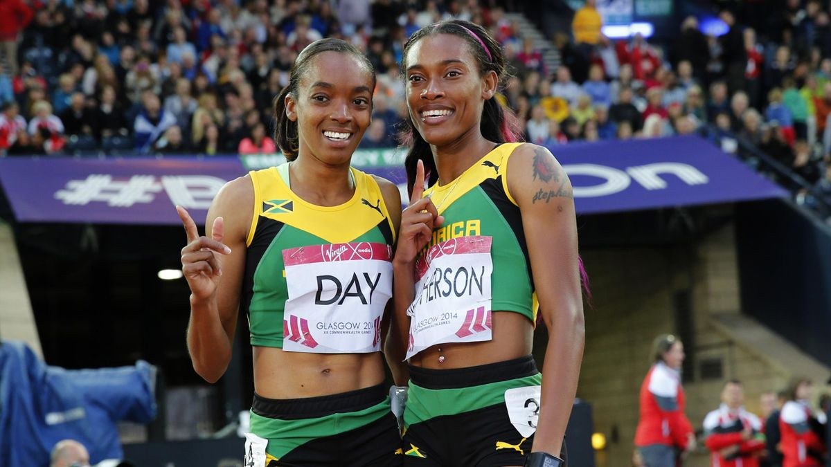 Stephanie Mcpherson (R) of Jamaica celebrates after finishing first place with compatriot and third place finisher Christine Day in the Women's 400m final at the Commonwealth Games in Glasgow (Reuters)