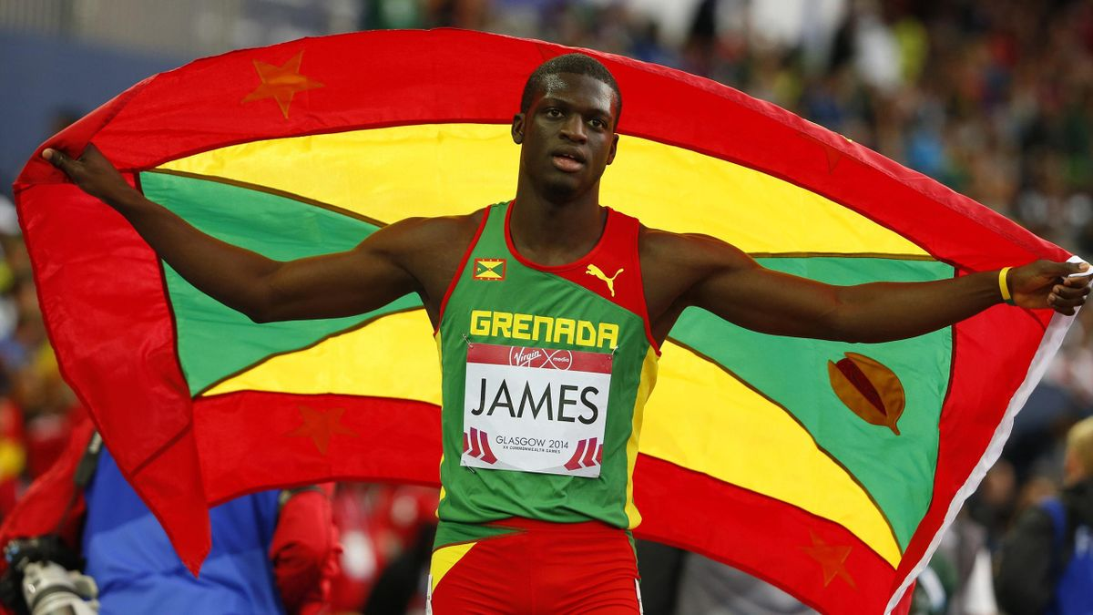 Kirani James of Grenada holds his national flag as he celebrates after winning the men's 400 metres at the 2014 Commonwealth Games in Glasgow (Reuters)