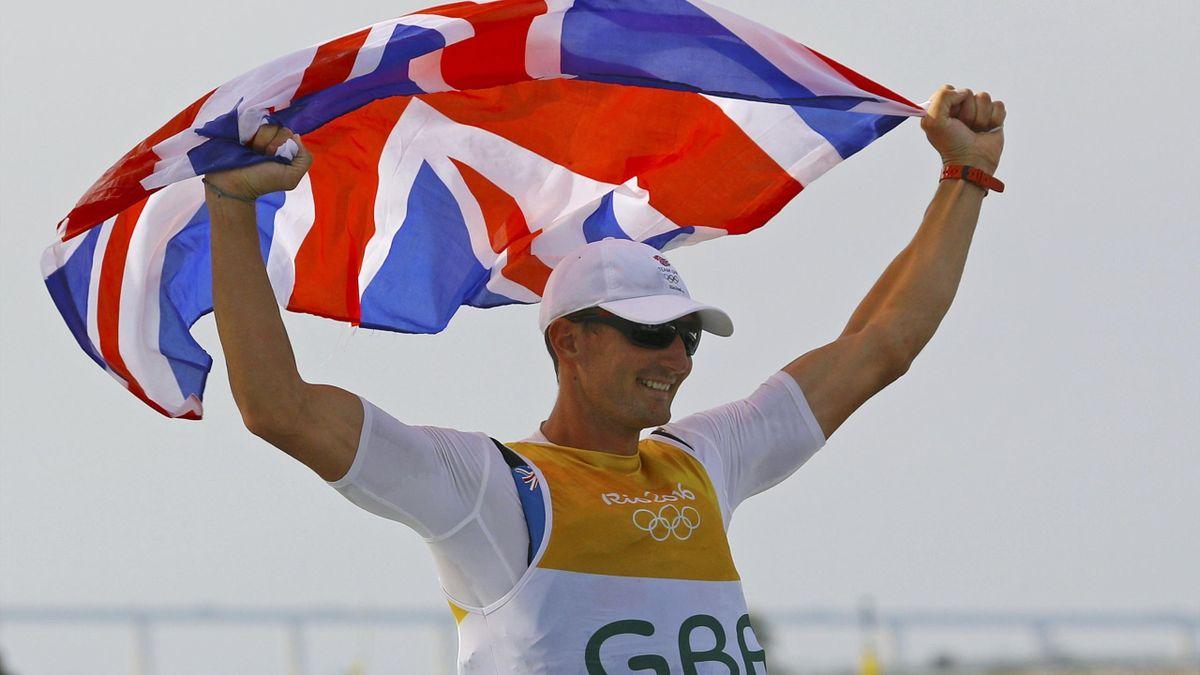 Giles Scott (GBR) of Britain celebrates gold medal.