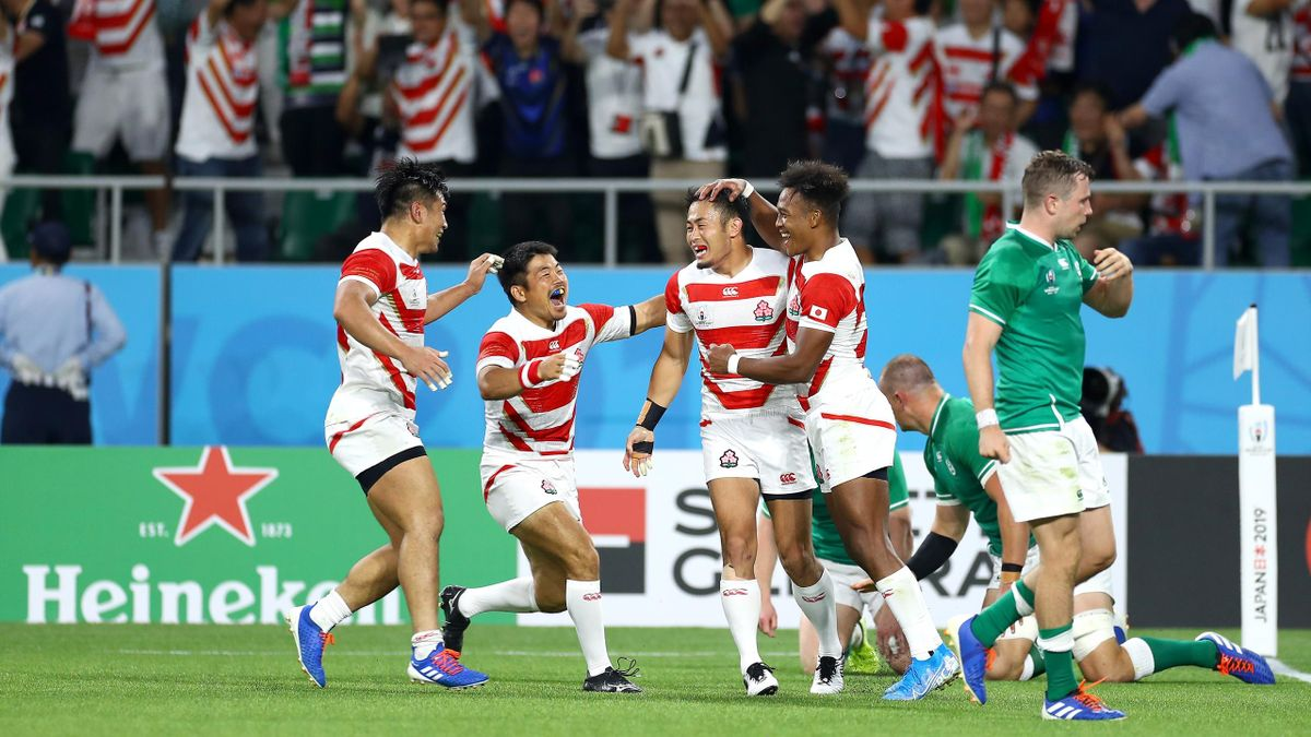 Kenki Fukuoka (3rd L) of Japan is congratulated by his team mates after scoring his side's try during the Rugby World Cup 2019 Group A game against Ireland at Shizuoka Stadium Ecopa on September 28, 2019.
